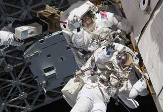 The last space walk from Discovery
