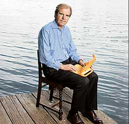 Nicholas Negroponte with a laptop