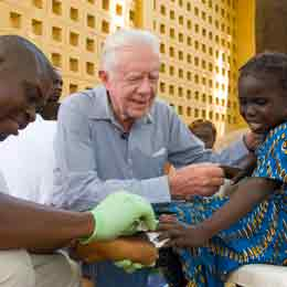 Jimmy Carter comforts a little girl