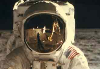 Armstrong seen in the reflection on Aldrin's visor